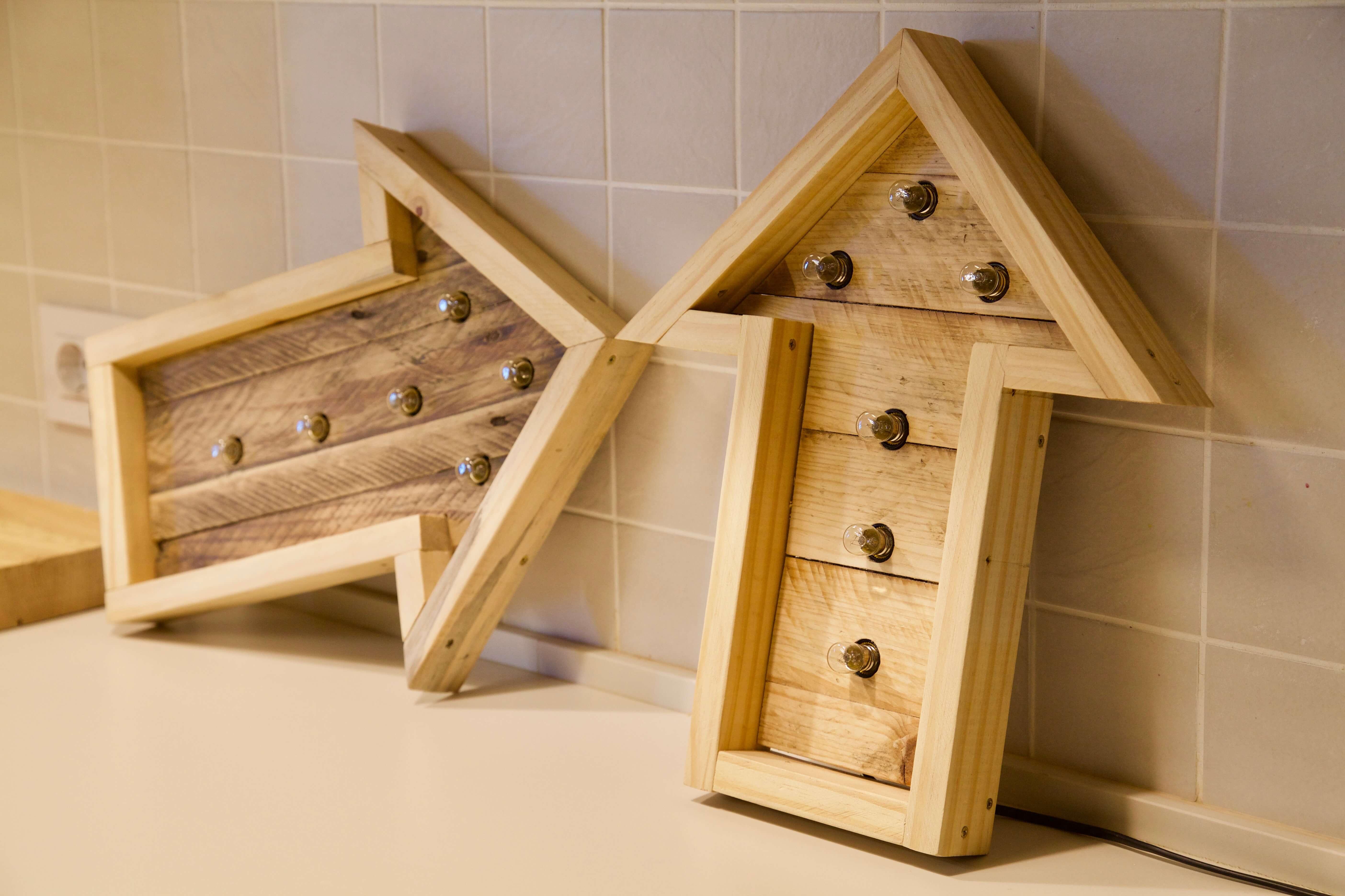 Lamparas con palets lijando la madera de palet para hacer - Estructuras con palets ...